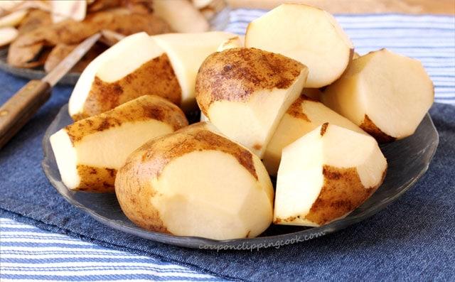 Peeled Russet Potatoes on Plate
