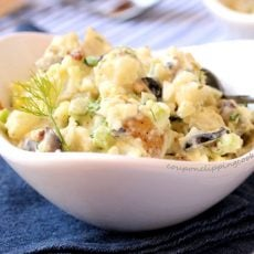 Loaded potato salad in bowl