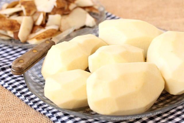 peeled potatoes on plate