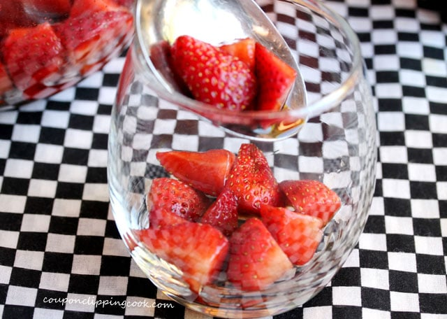 Add marinated strawberries to glass