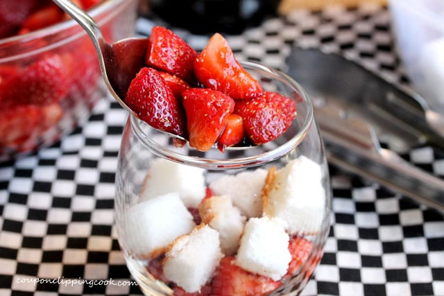 Add strawberries to a glass