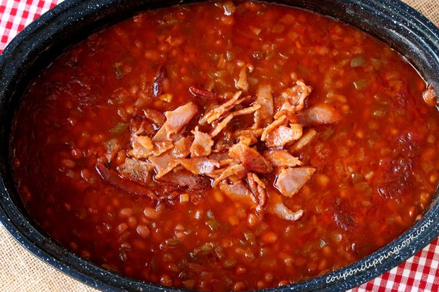 Bacon in pan of baked beans