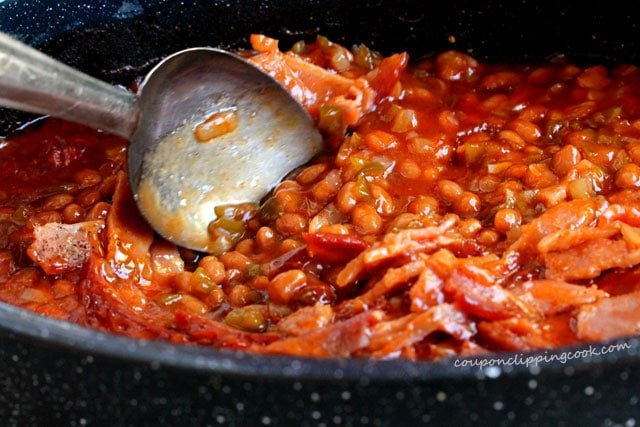 Stir bacon with baked beans