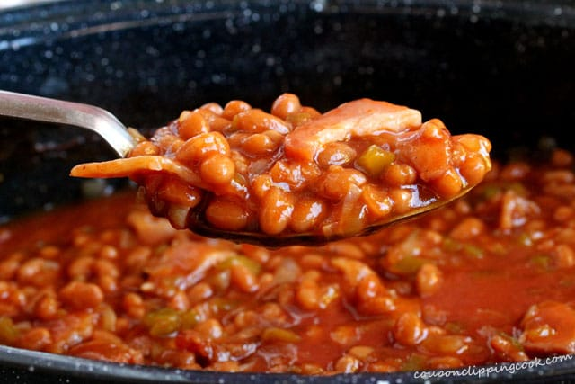 Spoon of baked beans with bacon