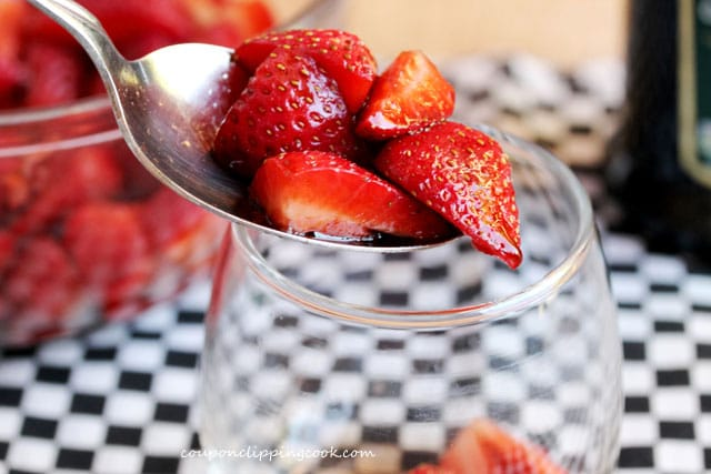 Add strawberries to glass