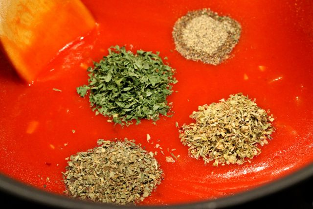 Spices and Herbs in Marinara pot