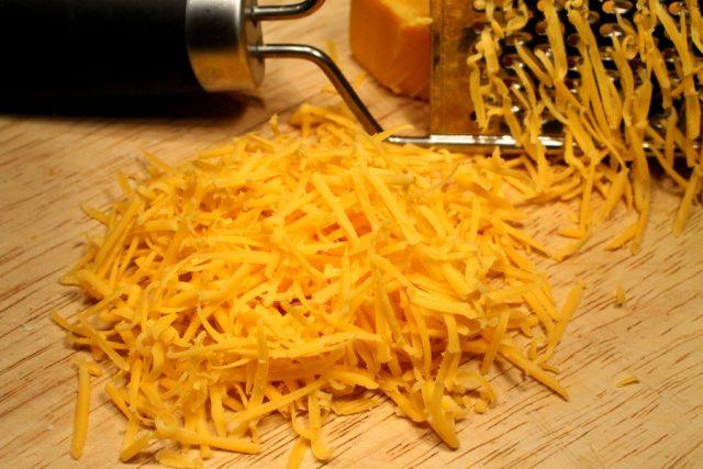 Shredded Cheddar Cheese on board