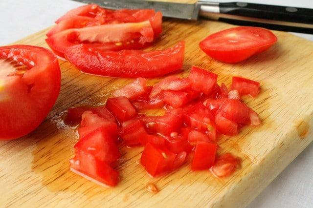Chopped Tomatoes on Cutting Board