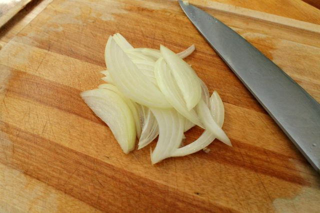 Sliced Onion on cutting board