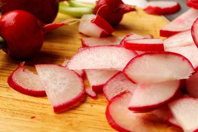 Sliced Radishes on cutting board