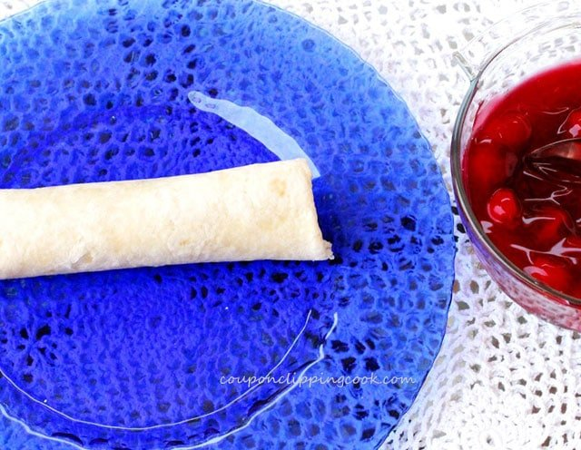 Rolled flour tortilla with cherries