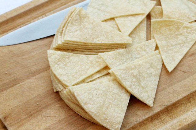 Cut Tortillas on cutting board