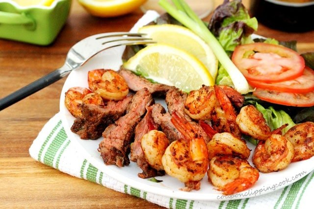Flap meat steak with shrimp on plate