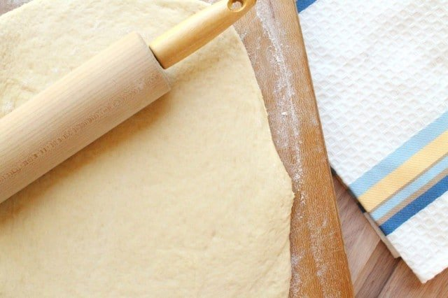 Roll Dough on Cutting Board