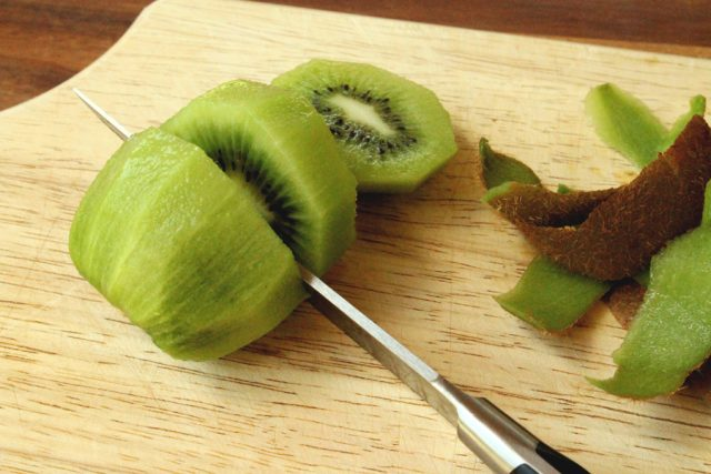 Cut Kiwi Fruit on cutting board