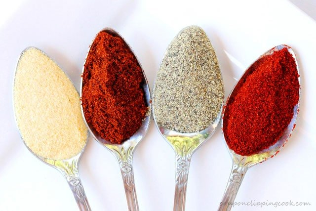 Spices in Spoons on Plate