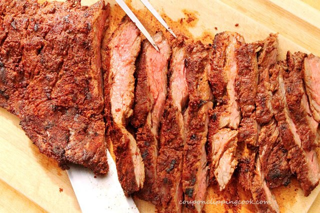 Sliced flap meat steak on cutting board