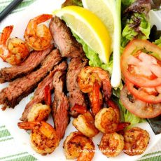 Sliced Steak and Shrimp on Plate