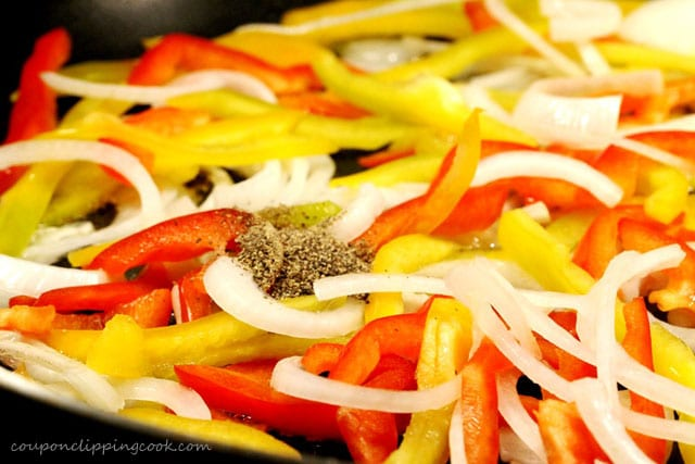 Pepper on bell peppers in skillet