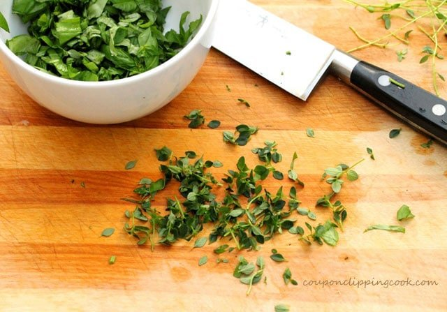 Chopped fresh thyme on cutting board