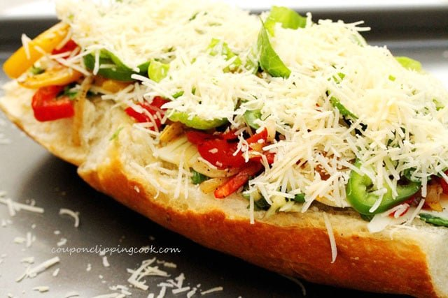 Shredded romano cheese on top of vegetables on bread