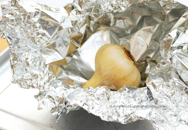 Roasted bulb of garlic in foil