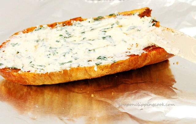 Spread cream cheese on garlic bread