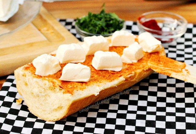 Cubes of cream cheese on garlic bread