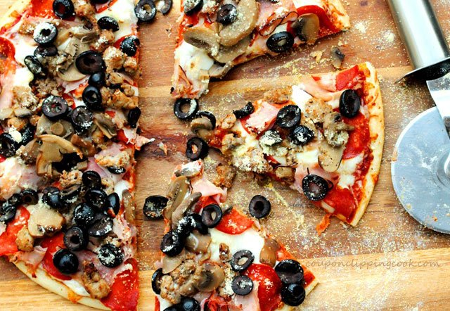 Pizza with black olives on board