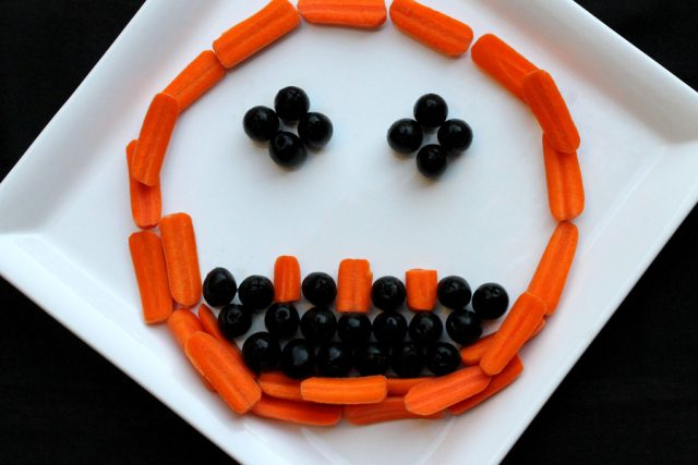Black Olives and Carrots on plate
