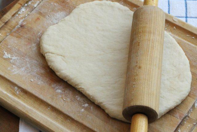 Roll Dough on Cutting Board