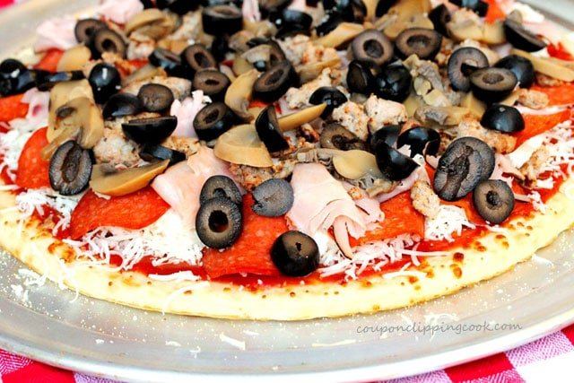 Black olives on pepperoni pizza