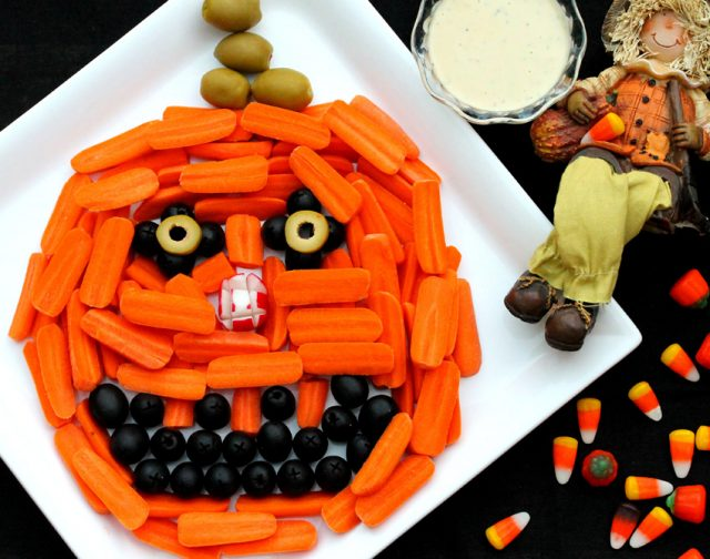 Pumpkin Head Relish Tray with Carrot and Olives on plate