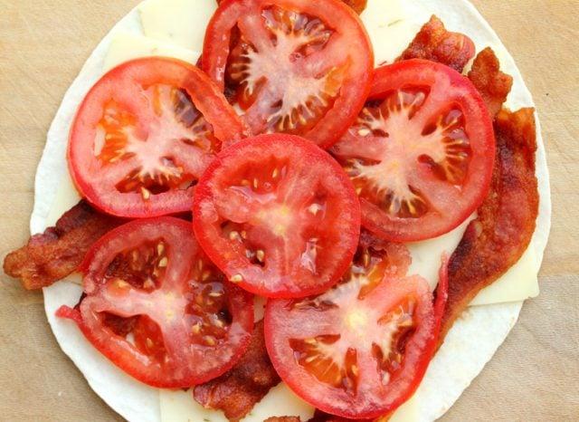 Sliced Tomato on Bacon on tortilla
