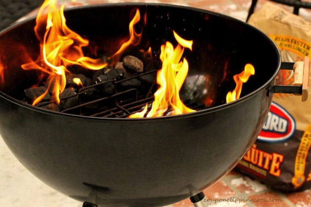 Heating coals in kettle barbecue