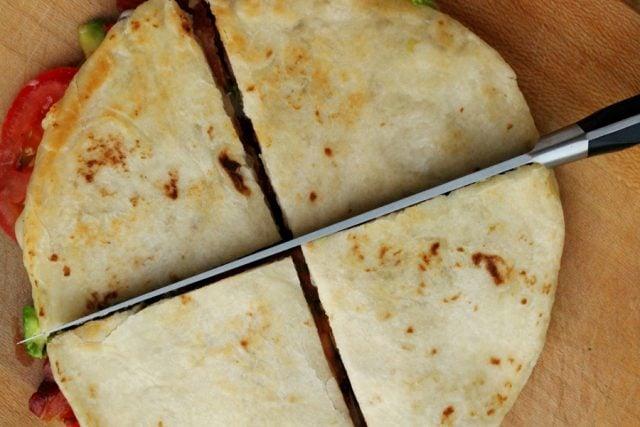 Cut Quesadilla on cutting board