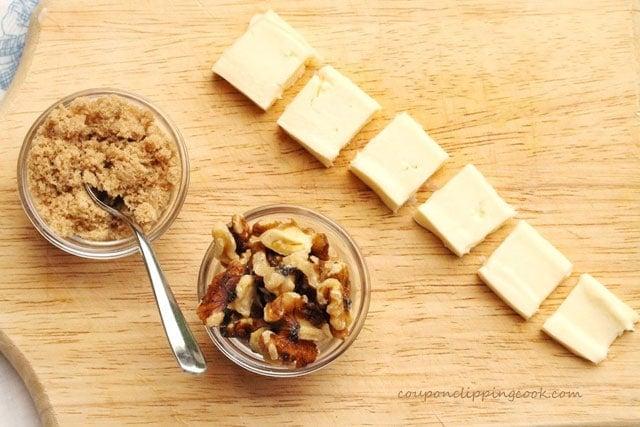 Cheese, walnuts brown sugar on board