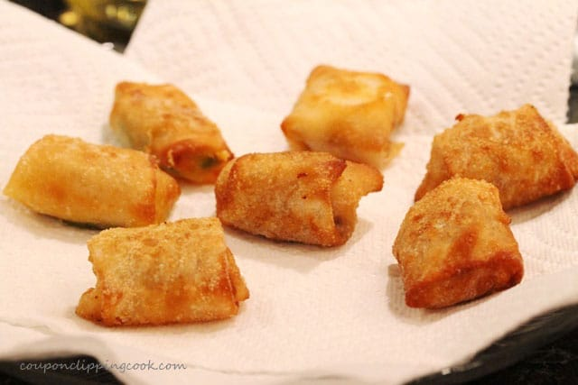 Fried won tons on plate with paper towel