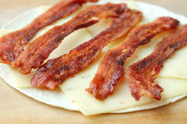 Bacon on Sliced Cheese on tortilla