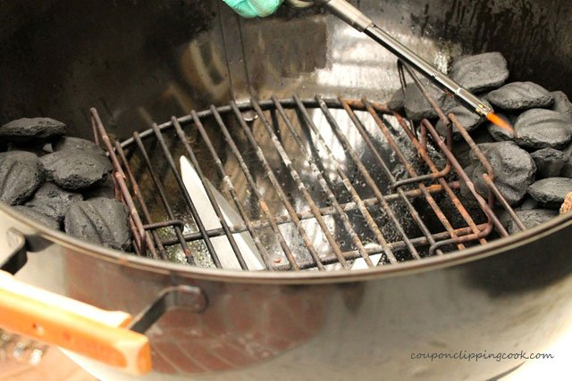 Lighting coals in kettle barbecue