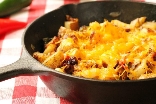 Cheesy Fried Potatoes in skillet
