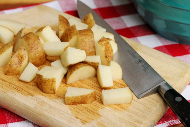 Cut Russet Potatoes on board