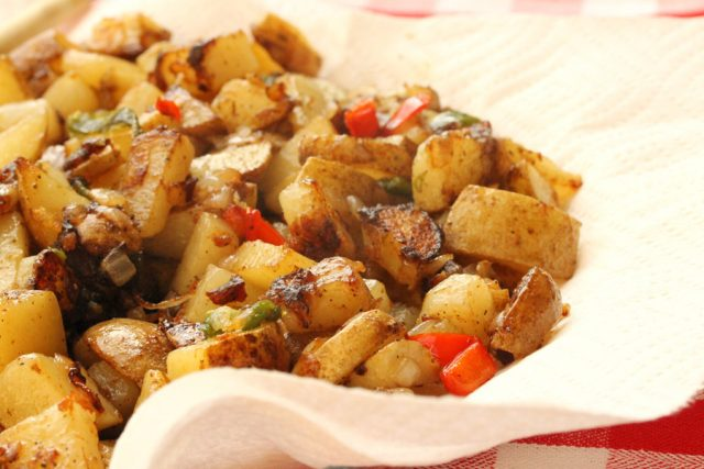 Fried potatoes on paper towel