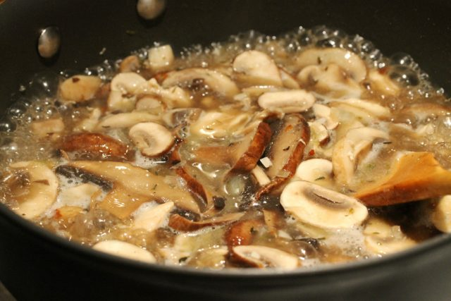 Cook Chicken and Mushrooms in pan