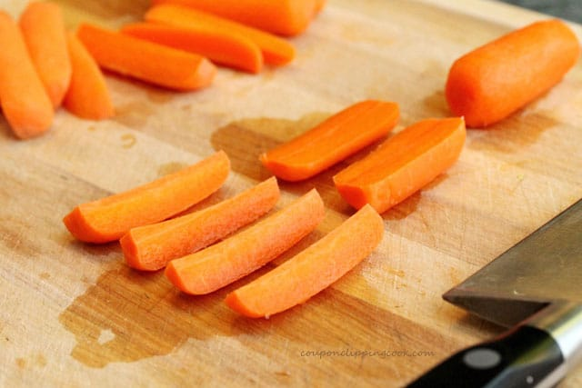 Cut carrot sticks on cutting board