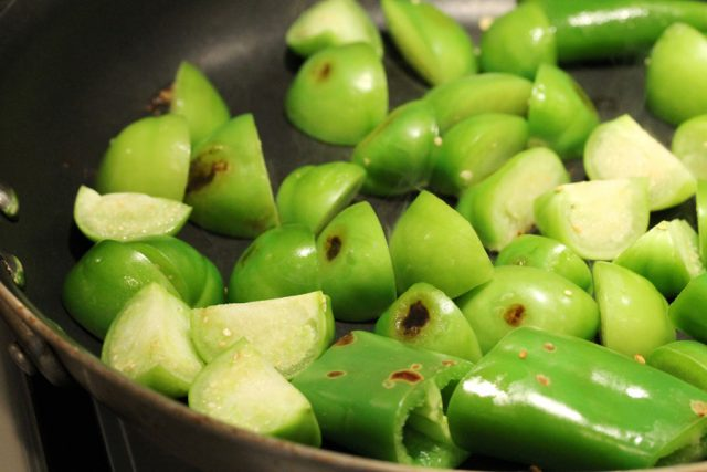 Cook Tomatillos and Peppers in pan