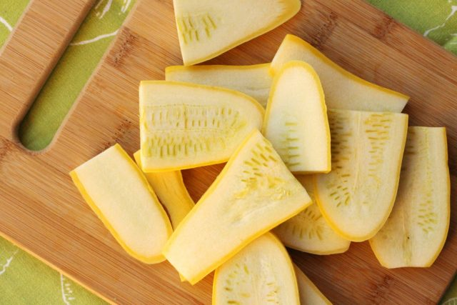 Sliced Yellow Squash on Board