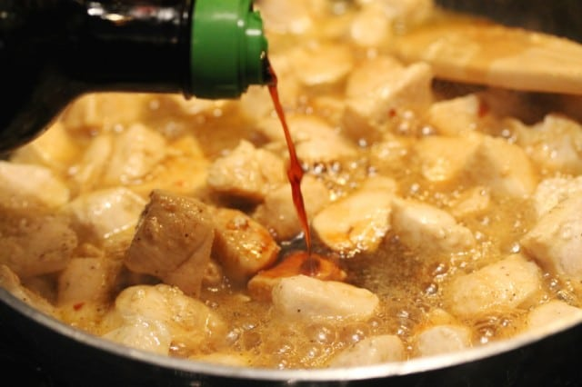 Pour Soy Sauce on Cooking Chicken