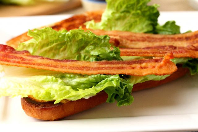 Bacon and lettuce on sandwich