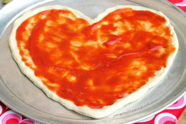 Tomato Sauce on Pizza Dough